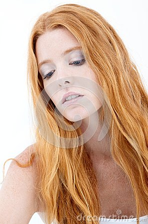 Facial portrait of troubled redhead