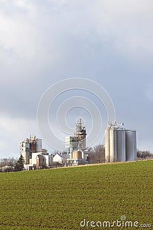 Factory behind field