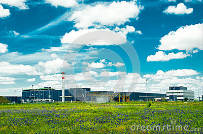Factory in the middle of a green meadow