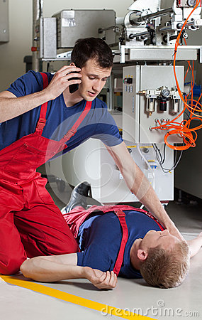Free Factory Worker Calling For Help After Accident Stock Photography - 43540782