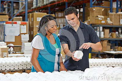Factory Worker Training Colleague On Production Line Royalty Free Stock Photo - Image: 29348545