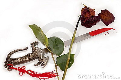 http://www.dreamstime.com/faded-rose-blood-stained-knife-means-the-end-of-thumb13330860.jpg