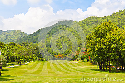 Fairway of a golf course beside the mountain