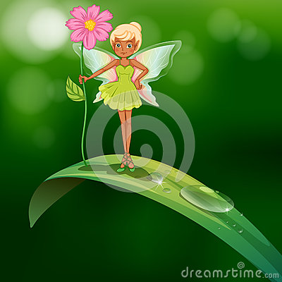 A fairy holding a flower standing above a leaf with a dew