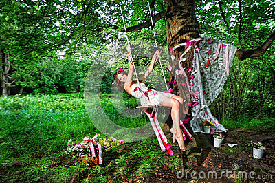 Fairy swinging on teeterboard
