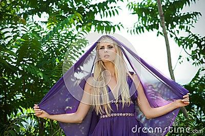 Fairy-tale - portrait of woman in purple with veil
