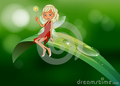 A fairy with a wand sitting at the leaf