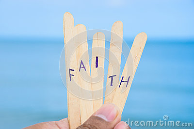 Faith on blue sea background.