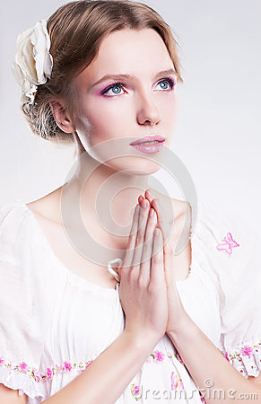 Faith. Young woman praying against her sin