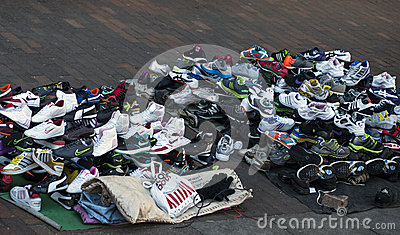 Fake branded footwear sold on a sidewalk Editorial Image