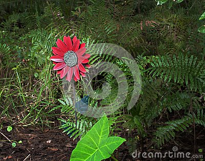 Fake flower in the woods centered