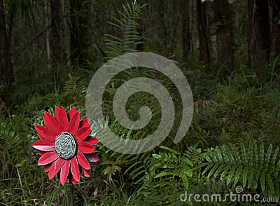 Fake flower in the woods left