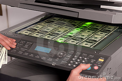 Fake money on copy machine in office