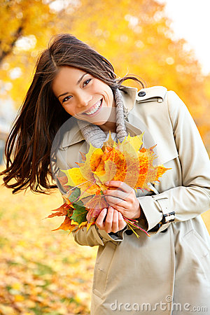 Free Fall / Autumn Woman Holding Colorful Leaves Royalty Free Stock Photo - 32583535