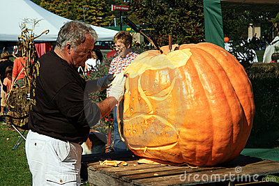 Fall Fest Pumpkin Carver - Frankfort, Michigan Editorial Stock Image