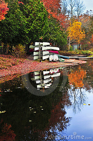 Free Fall Forest Reflections With Canoes Royalty Free Stock Images - 10868999