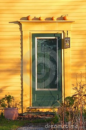 Fall: green door with pumpkins