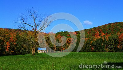 Fall mountain ridge surrounding old school house stock for Old deep house