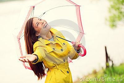 Fall woman happy after rain walking umbrella
