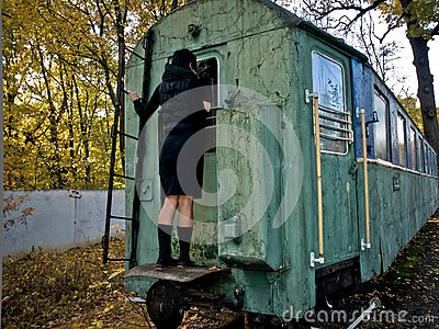 Fall, woman and rail coach