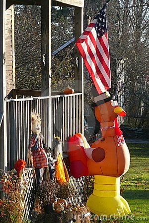 Fall: yard with Thanksgiving decorations and flag