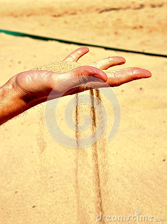 Falling sand from hand