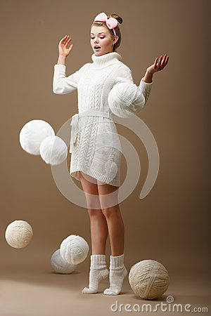 Free Falling Skeins. Surprised Woman In Woolen Knitted Jersey With White Balls Of Yarn Royalty Free Stock Images - 30679279