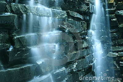 Falling water cascade and rocks Stock Photo