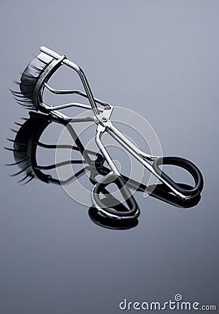False eyelashes and eyelash curler.