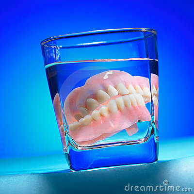 false teeth in a cup