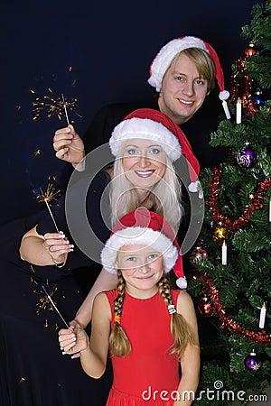 Família feliz com luzes