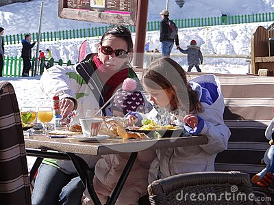 Families enjoy eating outdoors Editorial Photo