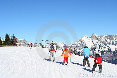 Families skiing in Alps