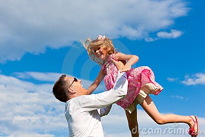 Family affairs - father and daughter playing in su