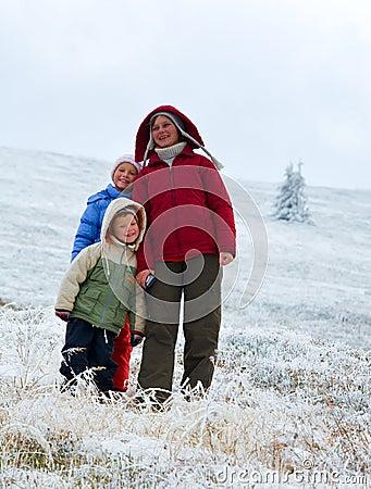Family on autumn  mountain plateau