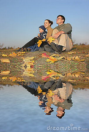Family with autumn water
