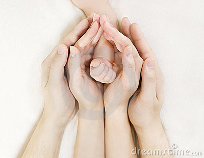 Family Baby hands, Newborn Kid hand into Mother Father Parents hands