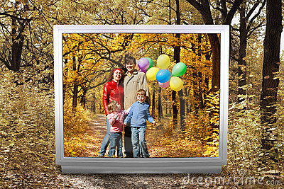Family with balloons in autumnal park in unreal tv