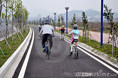 Family bike riders on new road