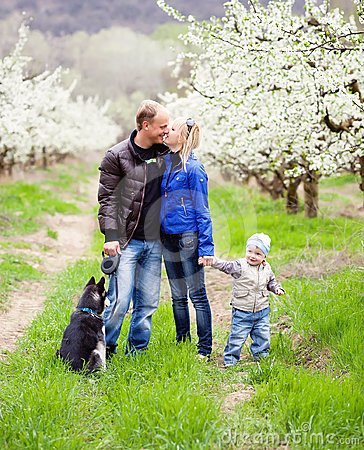 Family in blossom garden