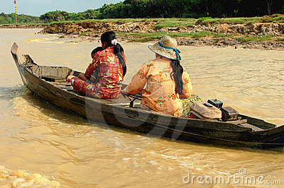 Family in boat,Cambodia Editorial Stock Image