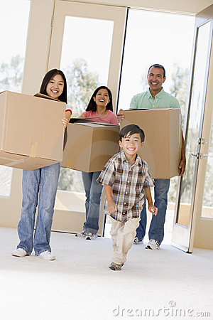 Family with boxes moving into new home