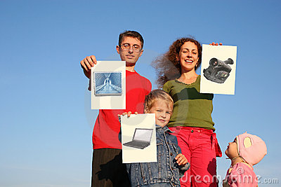 Family with boy and baby with wishes cards