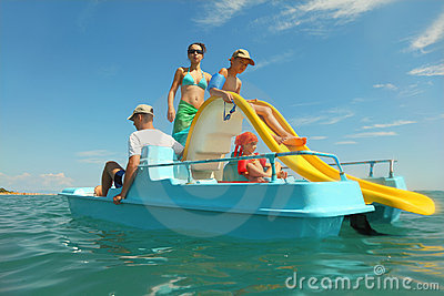Family with boy and girl on pedal boat