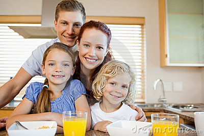 Family with breakfast behind the kitchen counter