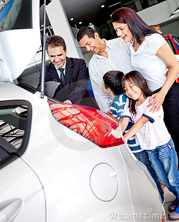 A picture of a family buying a new car
