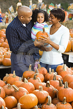 Free Family Buying Pumpkin. Stock Images - 3614874