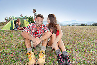 Family camping in countryside