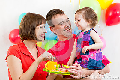 Family celebrate birthday of baby girl