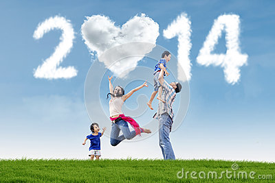 Family celebrate new year 2014 in the nature